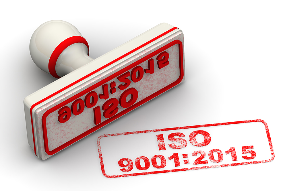 """Red seal and imprint """"ISO 9001:2015"""" on white surface"""